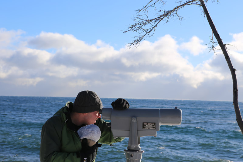 Viewing lake Superior through binoculars.