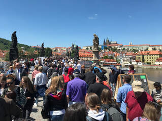 Prague Charle's Bridge with hordes of tourists